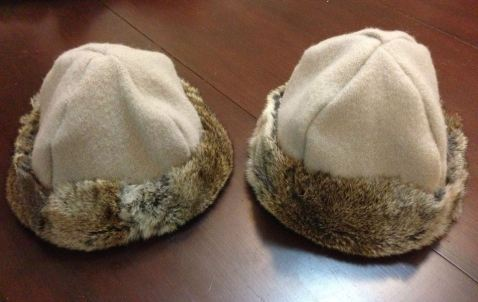 His and hers matching woollen Viking caps, trimmed with hare skin.